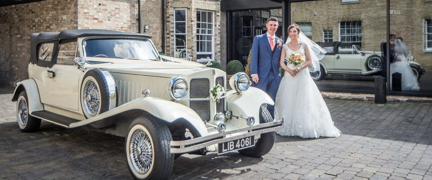 Married Couple and Vintage Car